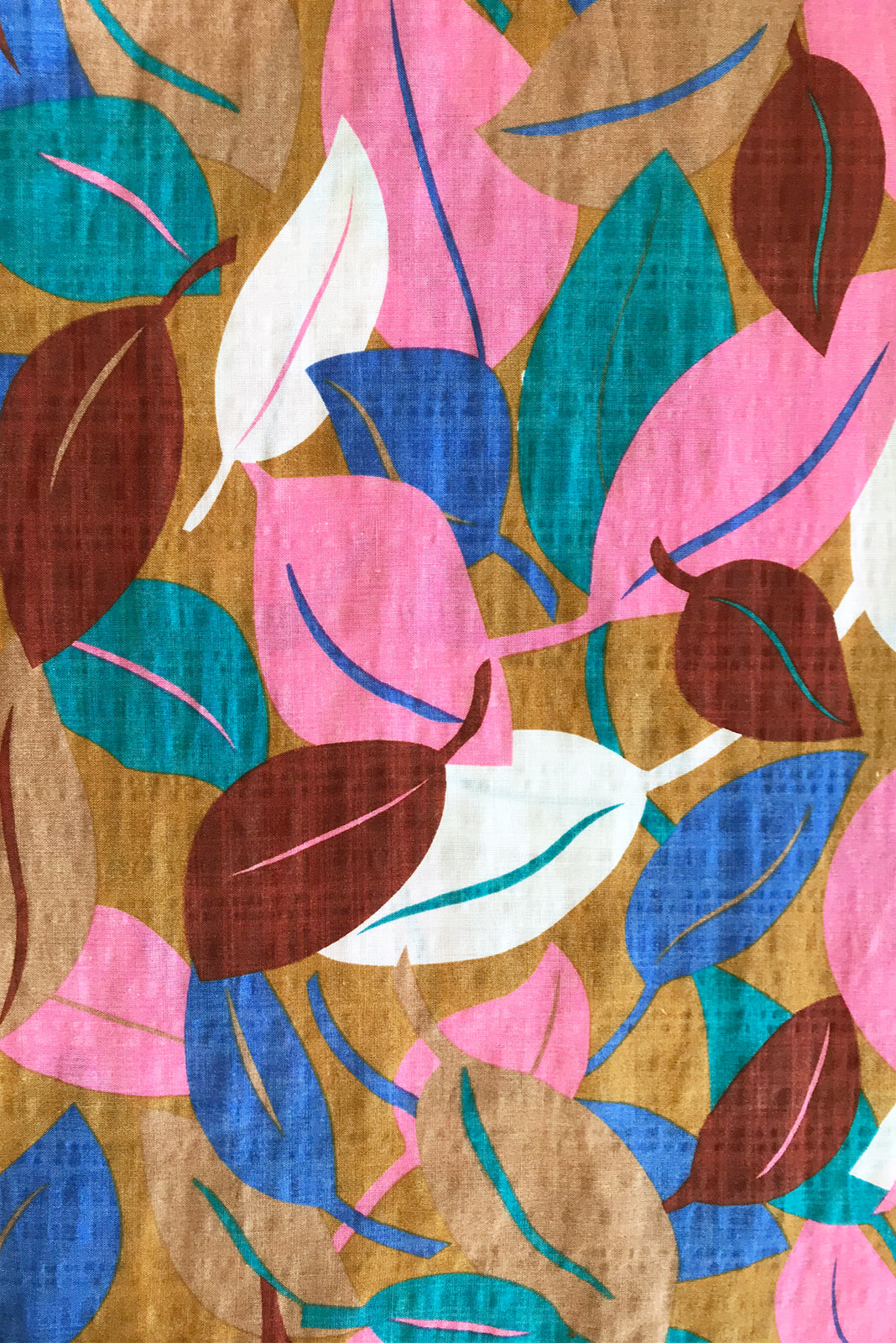 Fabric swatch of Jina Magic Leaf Maxi Dress featuring 70% cotton, 30% rayon in caramel base with white, pink, blue, teal and chocolate leaf print.