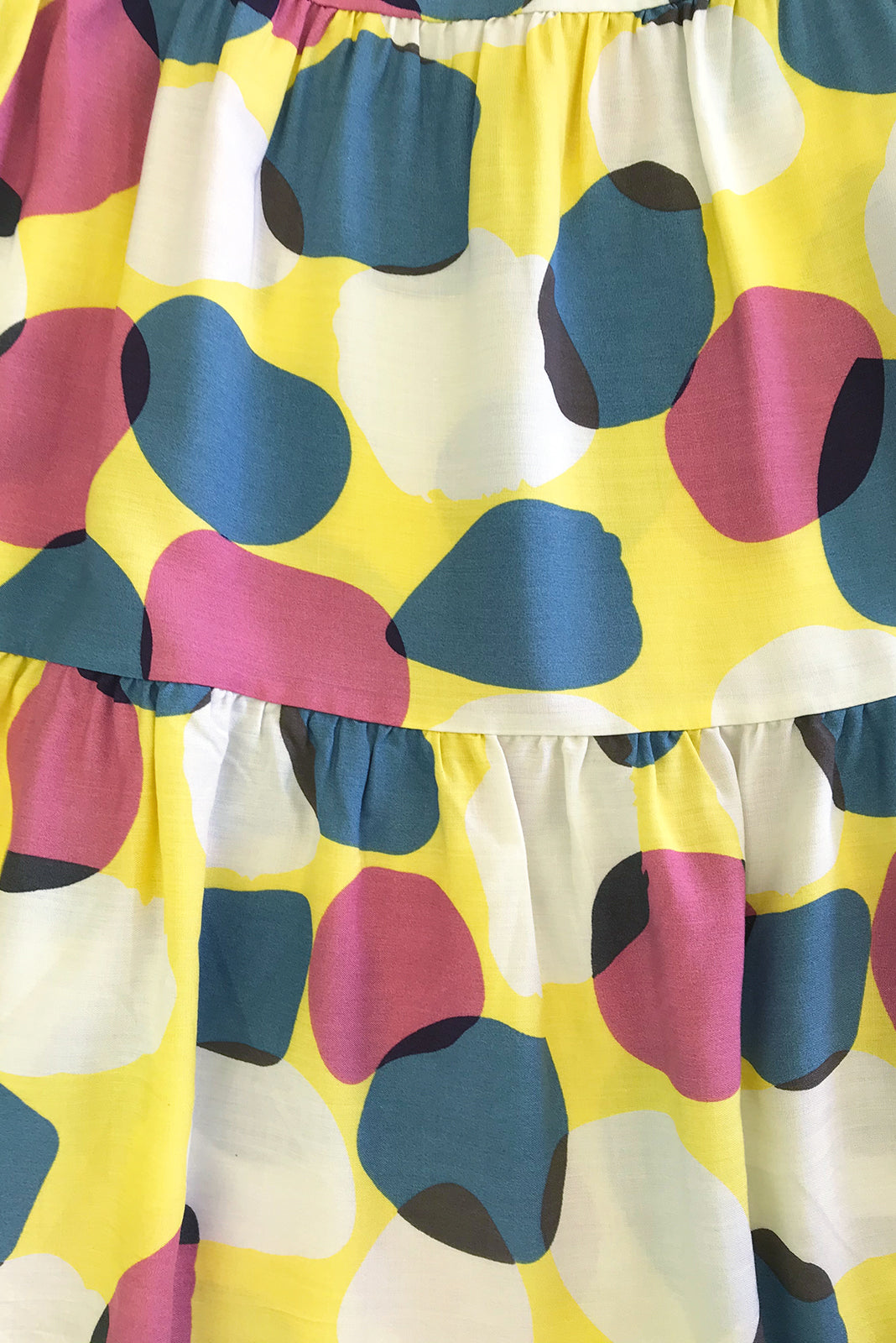 Fabric swatch of Jina Zinzi Yellow Dress featuring 100% rayon in pale yellow base with white, mauve and smoky blue spots print.