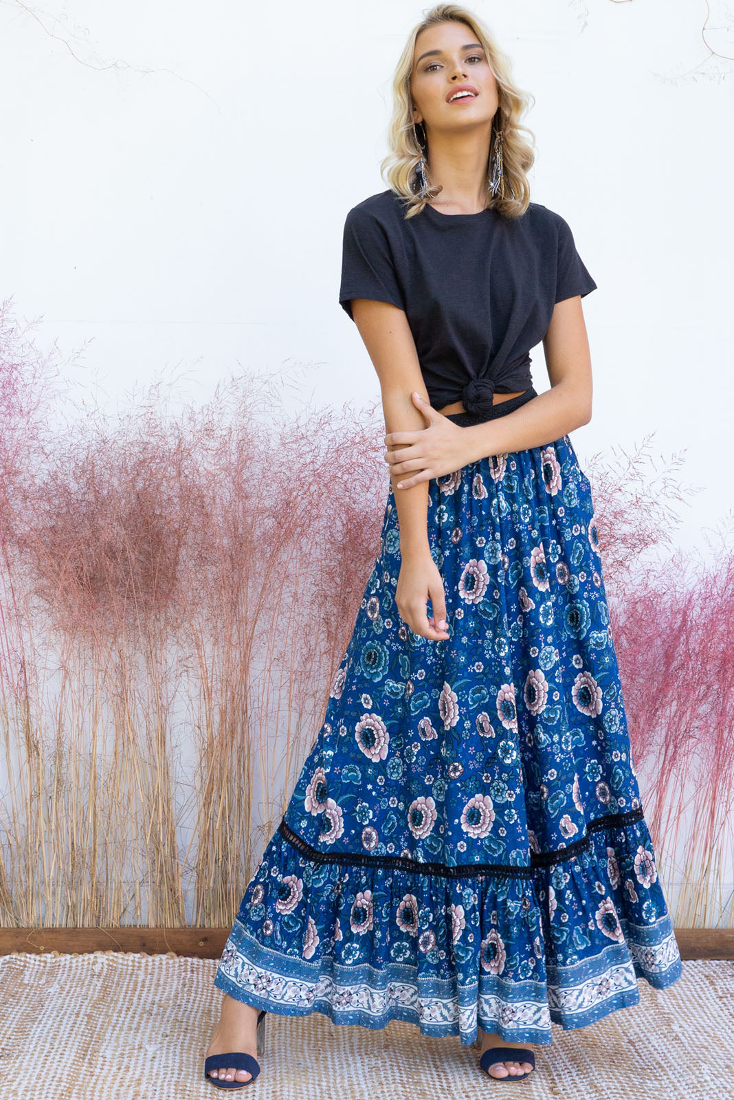 Joni Canyon Navy Maxi Skirt with a soft elastic waist band, side pockets, insertion lace and a deep frill on the hem it comes in a gorgeous vibrant bright navy, dusty pink and and soft cream intricate floral border print on rayon fabric