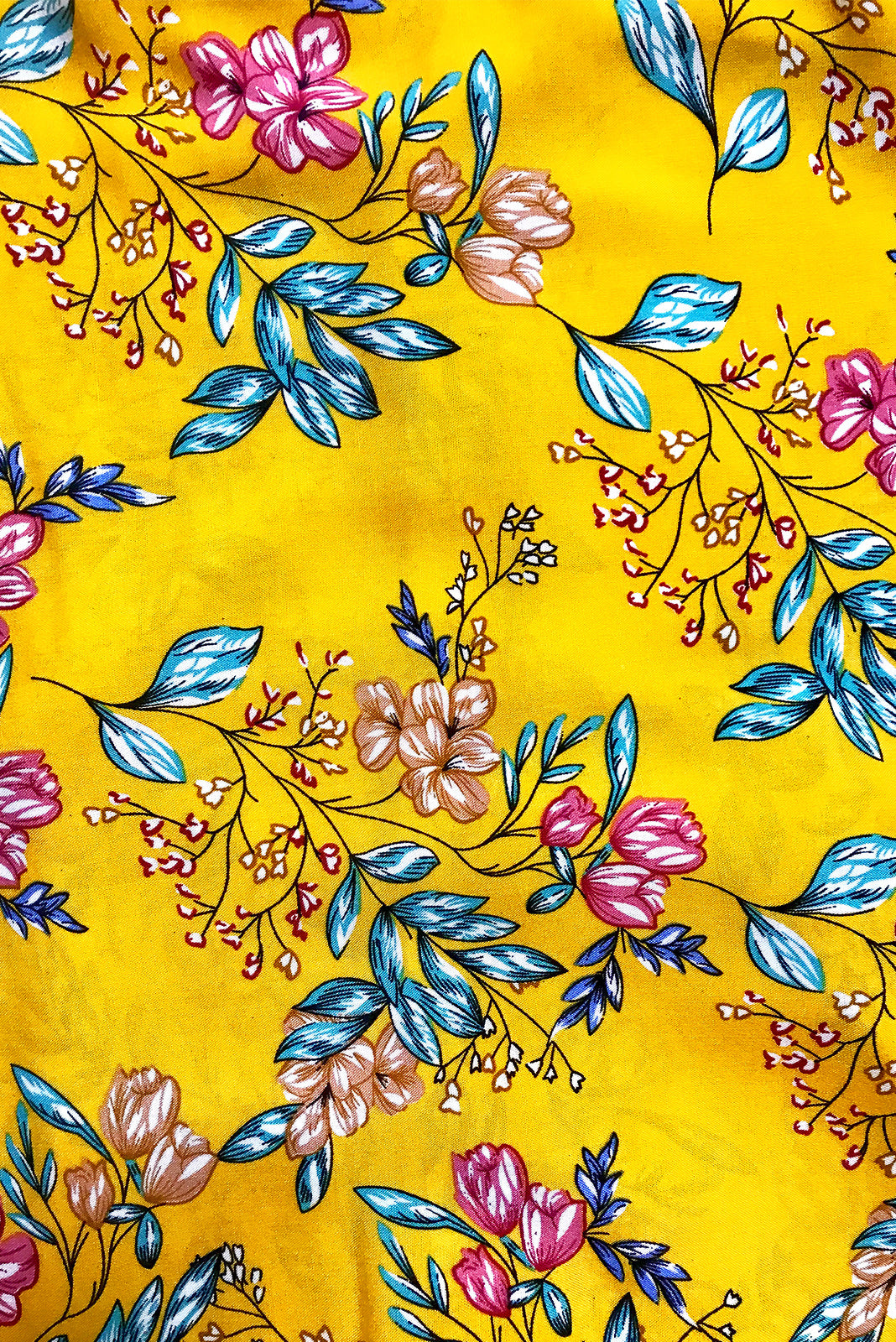 Fabric swatch, 100% woven viscose, bright gold base with medium blue, fuchsia, beige, black and white floral print.