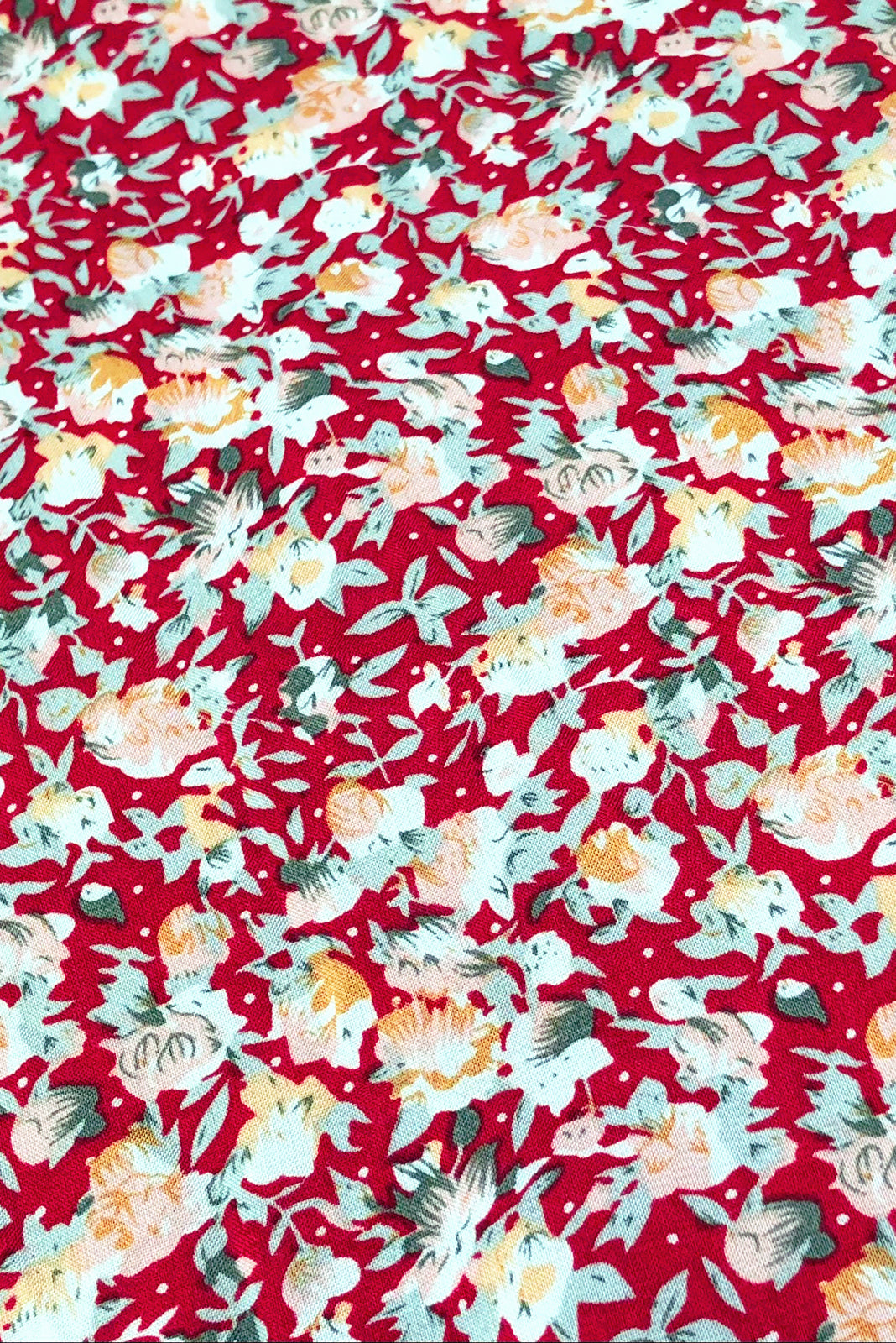 Fabric Swatch o fJuniper Cherry Blooms Maxi Dress featuring 100% viscose in red base with peachy pink vintage floral print.