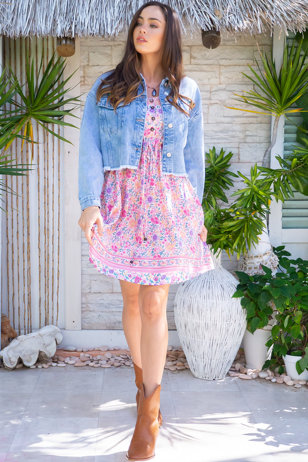 Juniper Fairy Floss Pink Mini Dress, bohemian summers style, 100% viscose, functional button down chest to waistline, side pockets, adjustable drawstring waist, pastel pink base with medium fuchsia, gold, purple and teal floral print.