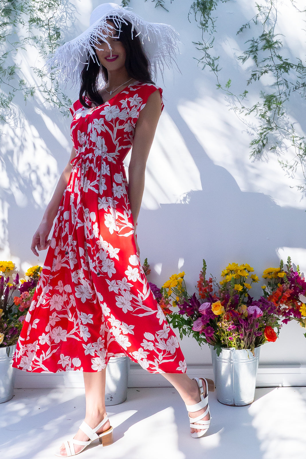 The Juniper Red Shadow Maxi Dress features functional button down detailing to waistline, side pockets ,adjustable drawstring waist and 100% rayon in red base with crisp cream floral print.
