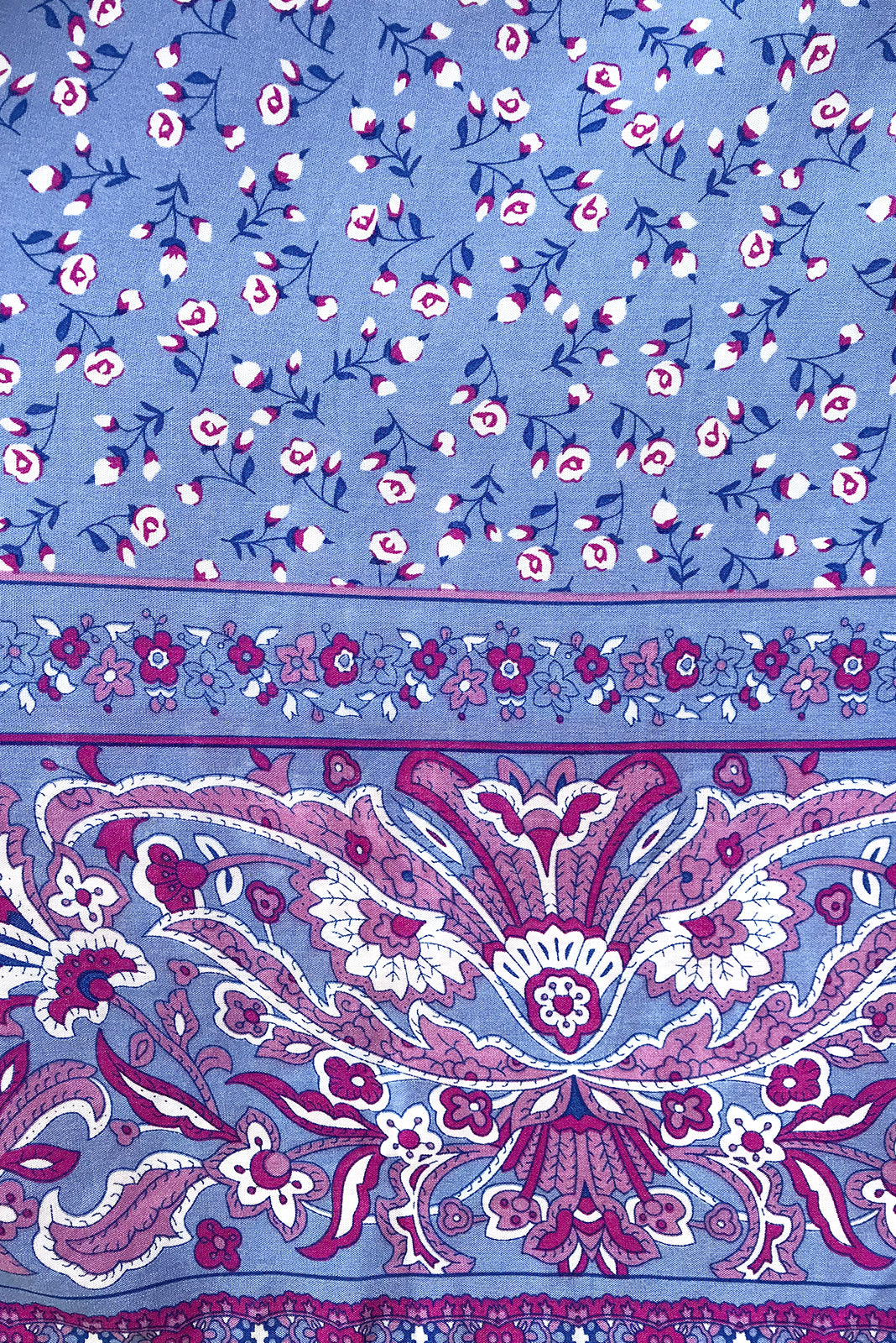 Fabric Swatch of Ace Maya blue Dress  featuring 100% rayon in soft, purply blue base with small floral accents and border feature.
