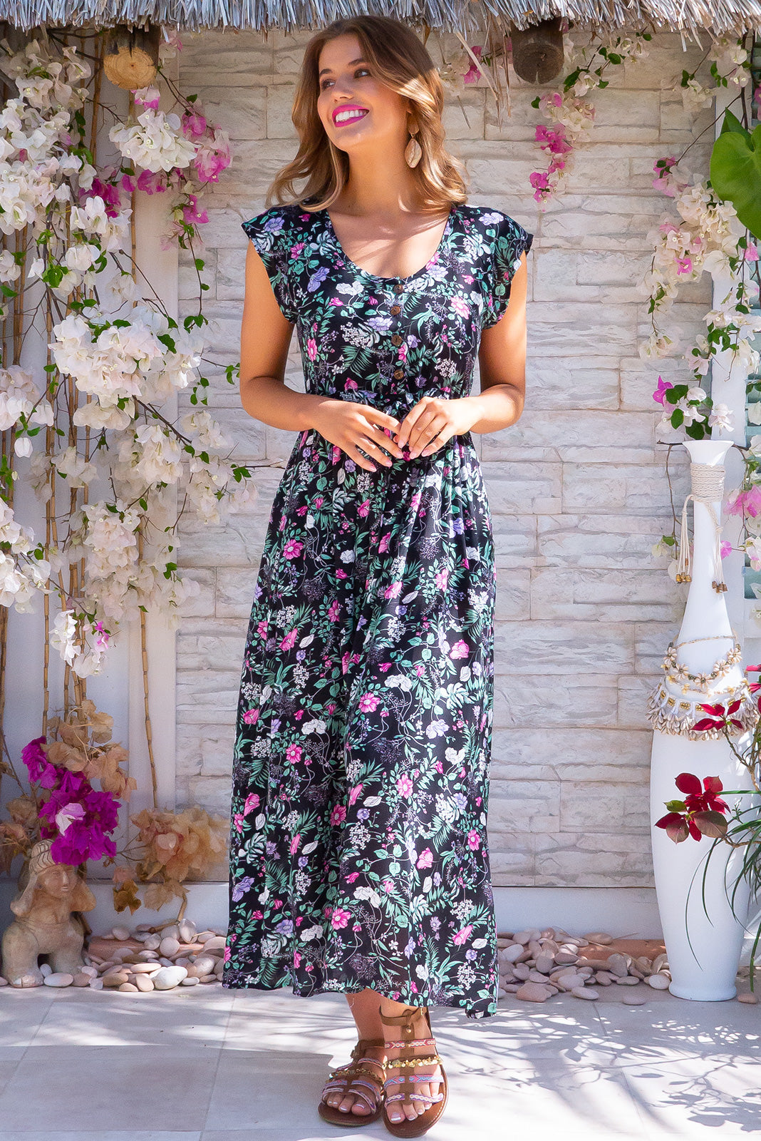 Juniper Maxi Axia Black Dress button top front and drawstring waist, also features side pockets and a vintage floral design.
