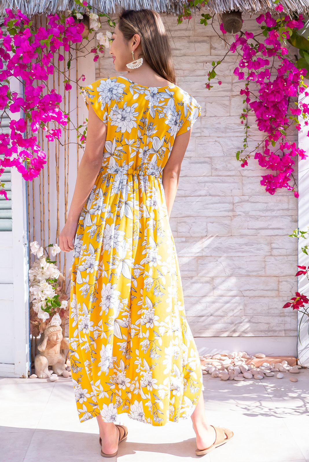 Juniper Maxi Golden Etch Dress featuring button front top, drawstring waist, butter yellow woven 100% rayon fabric, side pockets and cap sleeves.