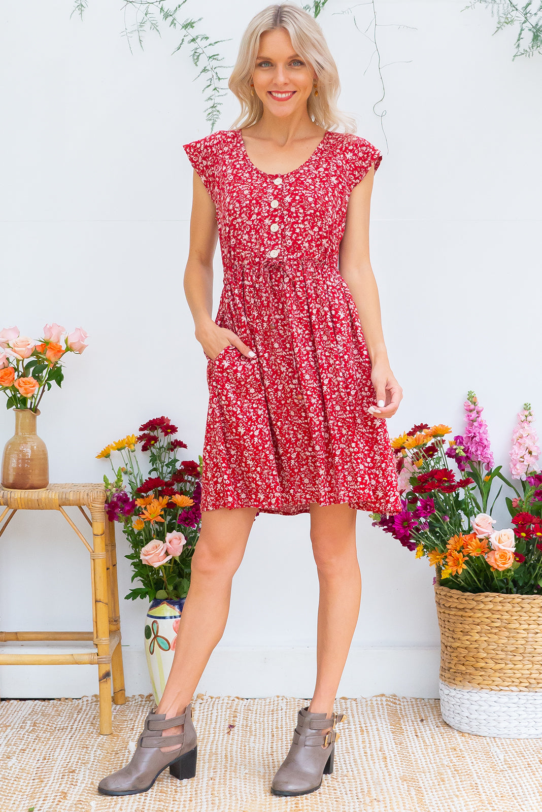 Juniper Red Earth Dress with a button front, cap sleeves, side pockets and a full skirt in a rust red floral print on a 100% woven rayon chic and effortless style
