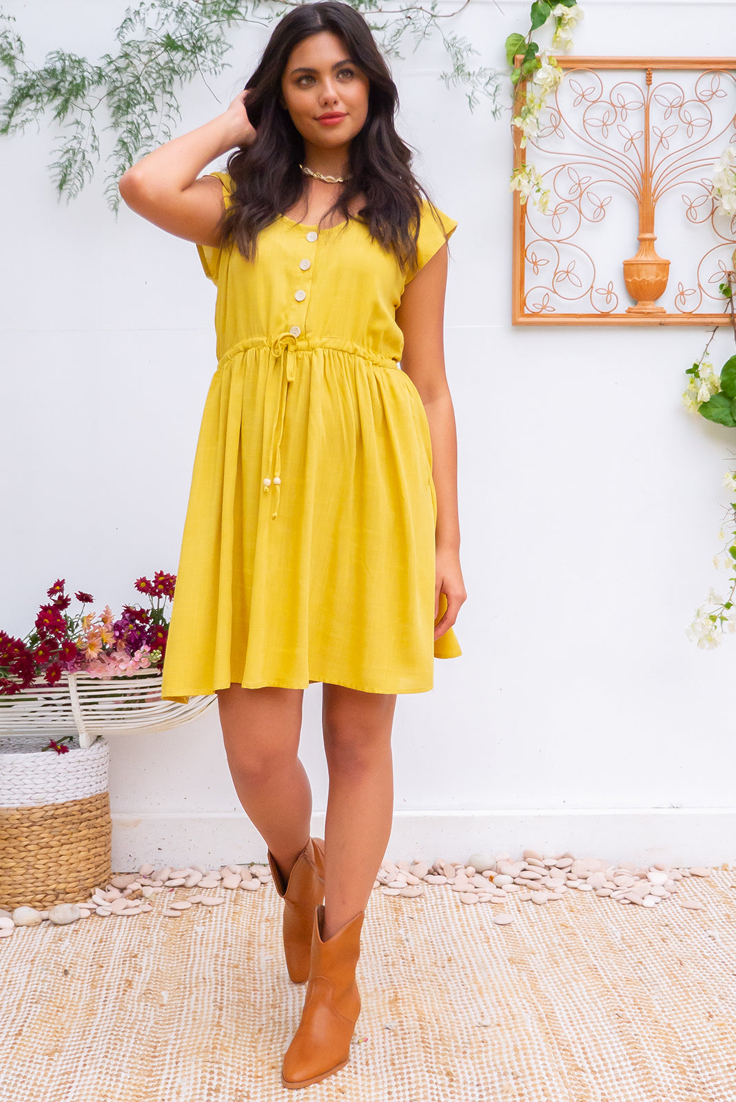 Juniper Space Gold Dress with a button front, cap sleeves, side pockets and a full skirt in textured 100% woven rayon plain gold colour, chic and effortless style