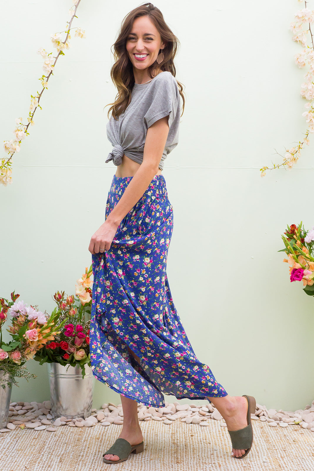 Laguna Lapis Blooms Maxi Skirt with a soft ruched elastic back and pockets in bright lapis blue with a bright floral bohemian vintage style print on crinkle rayon