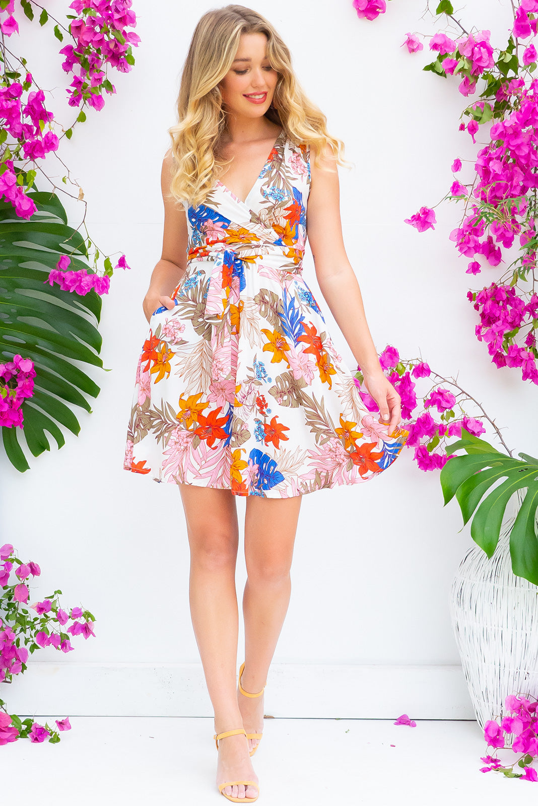 Little Darling Island Sands Dress tie front wrap dress with an elastic waist and a plunging v neckline made from a 100% rayon fabric in a stunning graphic tropical print