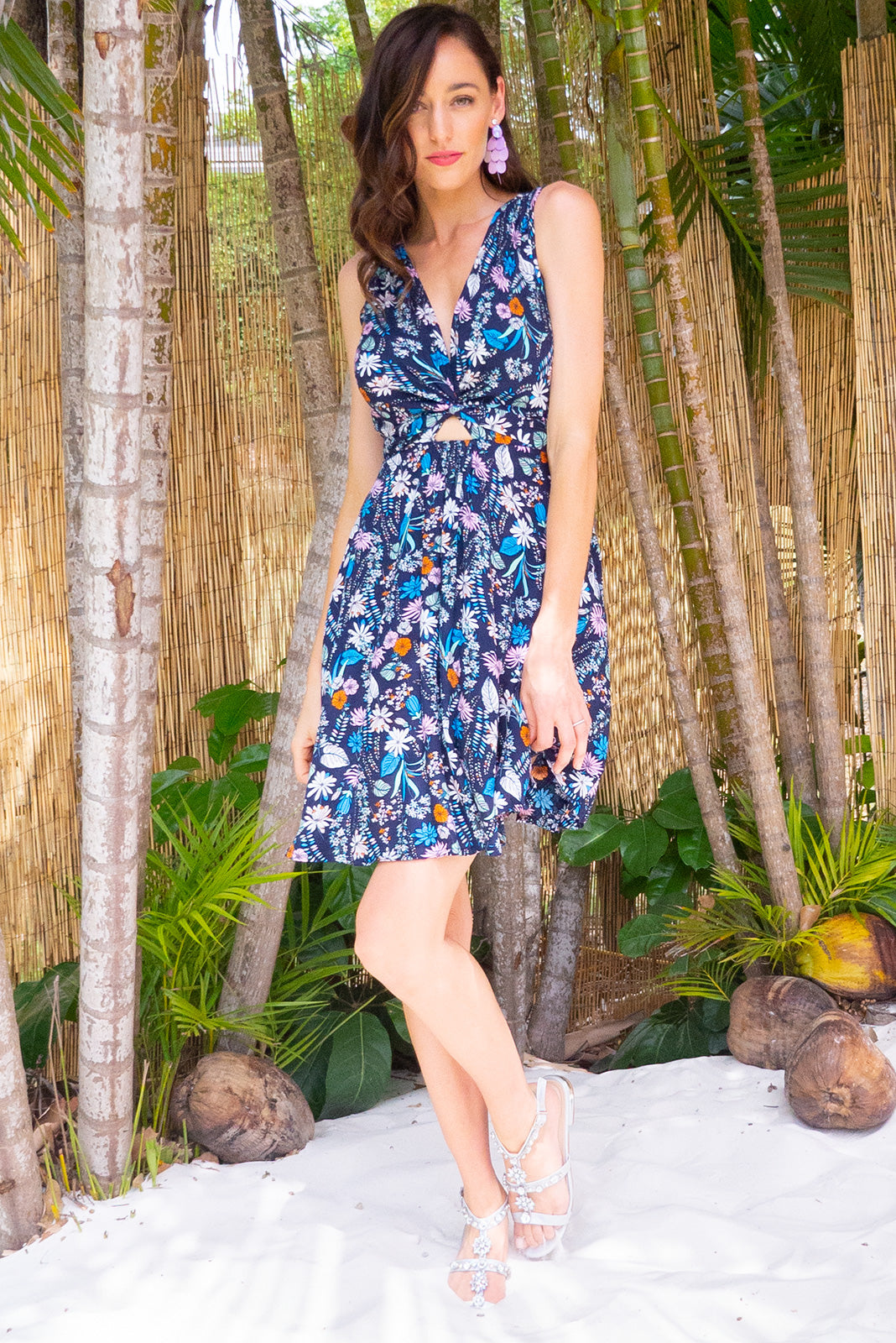 Little Darling Palma Navy Wrap Dress tie front wrap dress with an elastic waist and a plunging v neckline made from a 100% rayon fabric in a navy floral print
