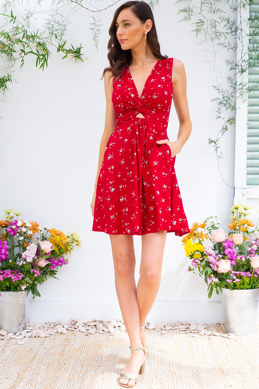Little Darling Red Snow Wrap Dress tie front wrap dress with an elastic waist and a plunging v neckline made from a 100% rayon fabric in a bright red ditzy floral print