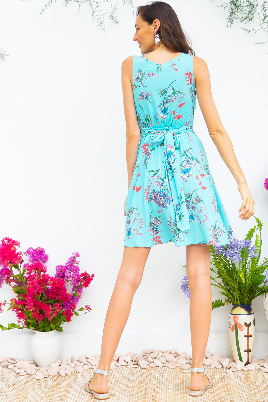 Little Darling Turquoise Skies Dress tie front wrap dress with an elastic waist and a plunging v neckline made from a 100% rayon fabric in a stunning pale sky blue and floral print