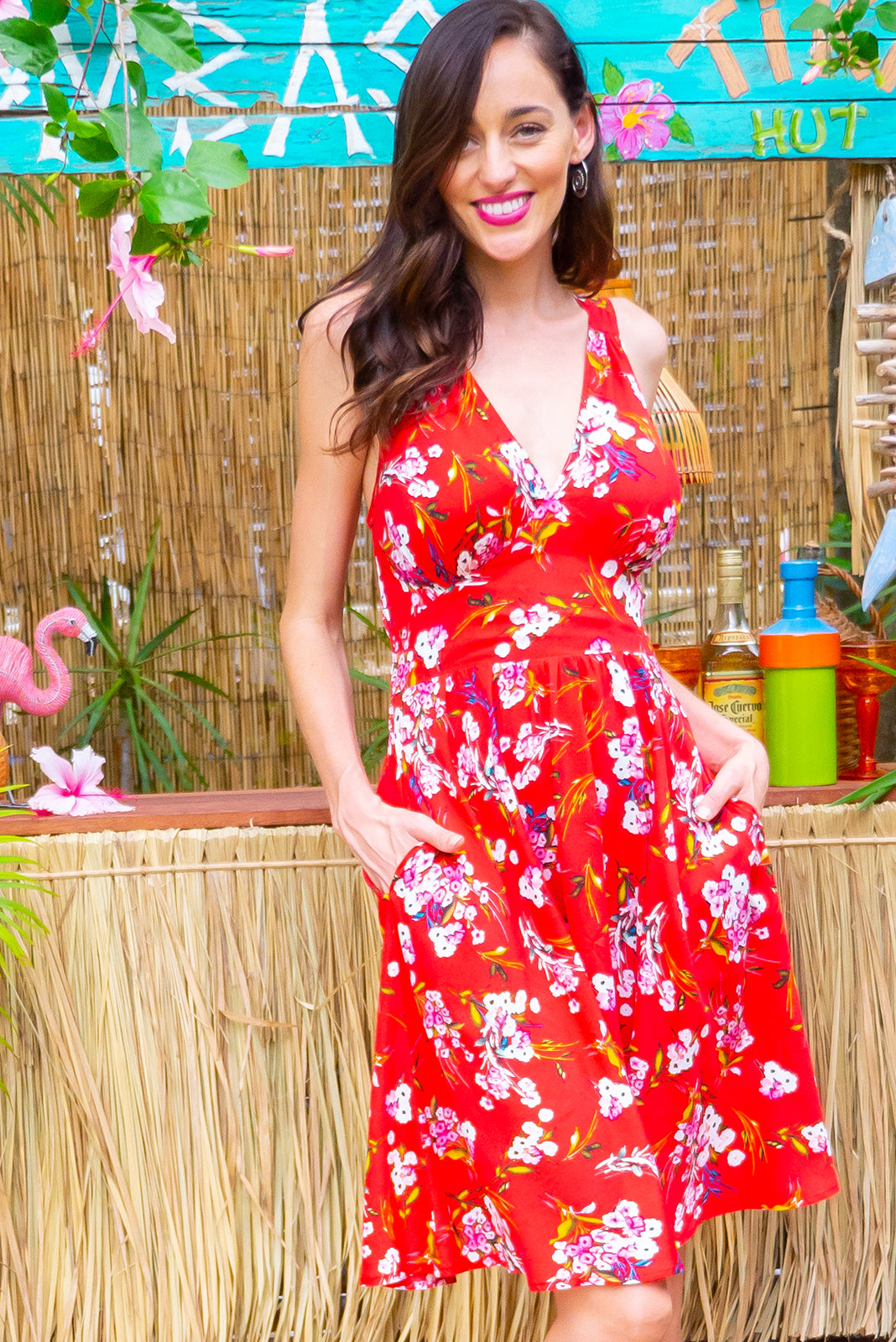 Little Lola Loves Red dress features a vintage inspired fitted basque waist and elasticated waist with a sleeveless design and deep v neck the fabric is a soft woven rayon in a bright red floral print