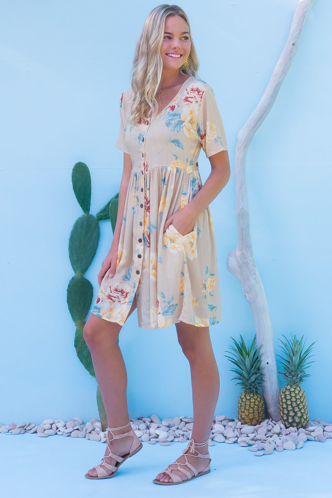 Little Rock Antiquity Gold button front dress in a pastel sandy yellow floral print on crinkled rayon