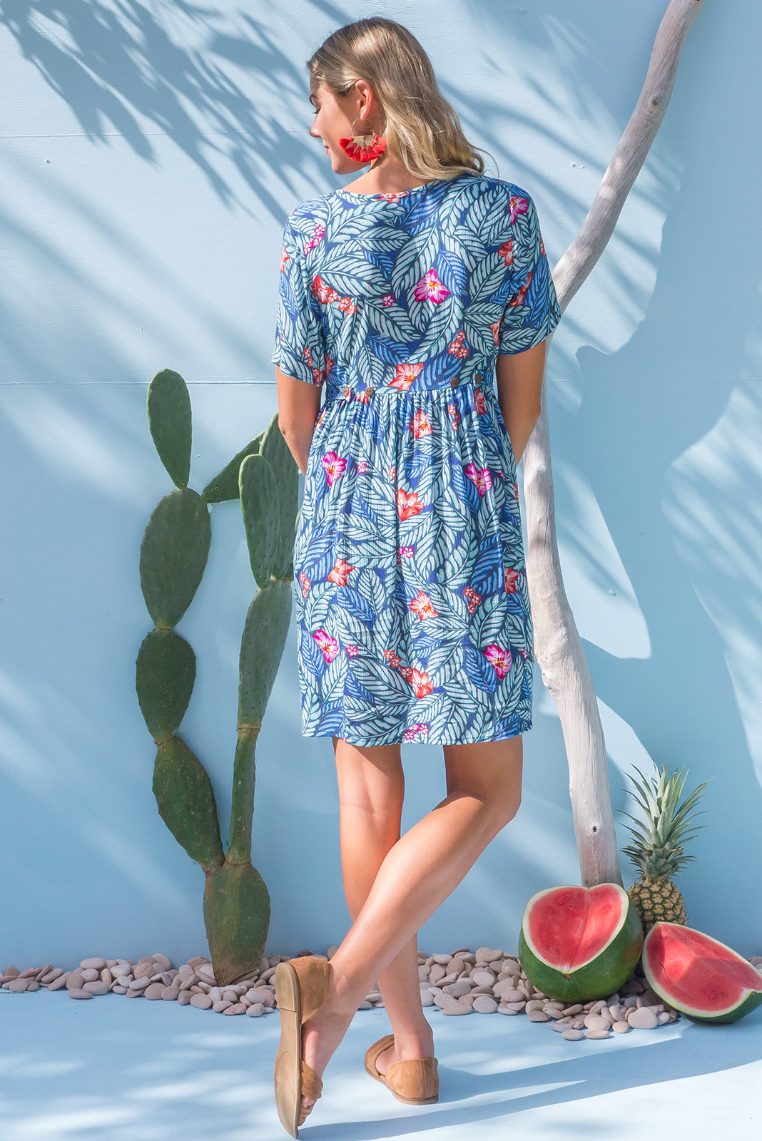 Little Rock Jungle Flowe button front dress in a softy sky blue tropical leaf print on crinkled rayon
