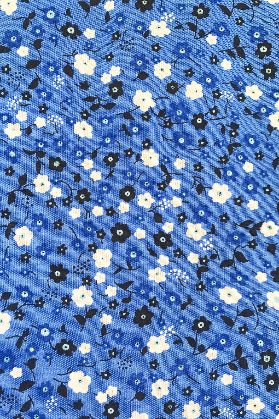 Fabric swatch of Lizzie Azure Flowers Dress featuring 100% rayon in azure blue base with ditzy floral print.