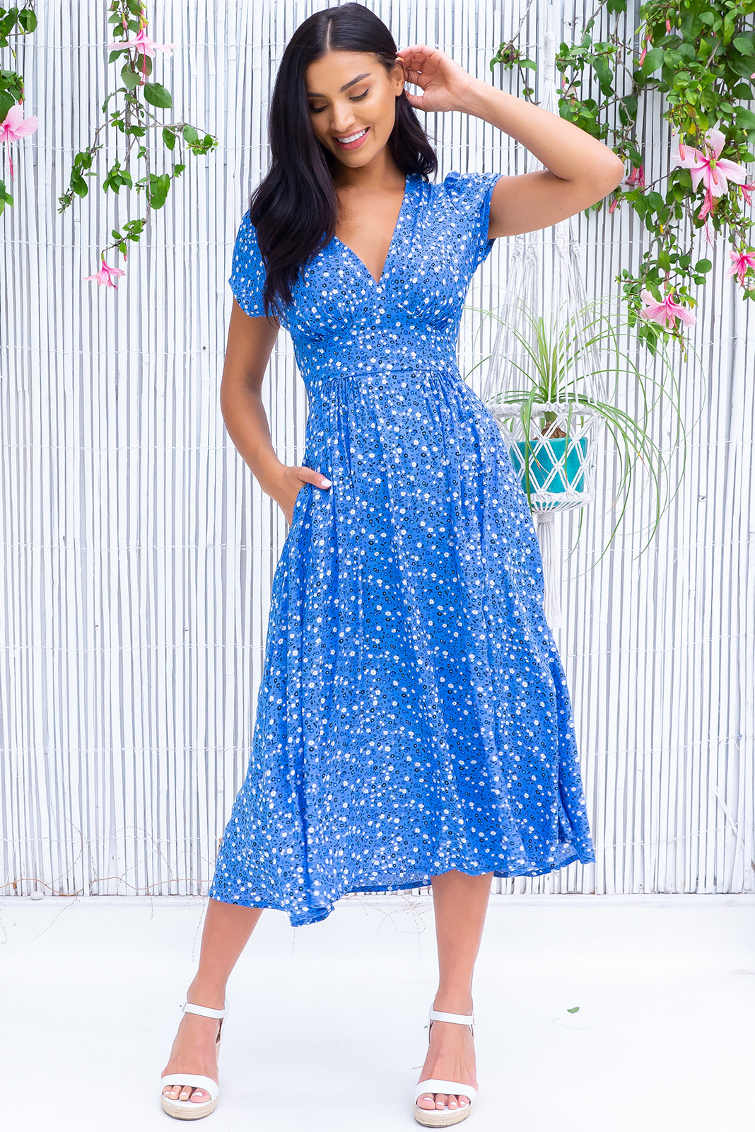 The Lizzie Constellation Blue dress features fitted basque waist with gathered bust, waist features elastic shirring at back, petite side pockets and 100% rayon in azure blue base with ditzy floral print.