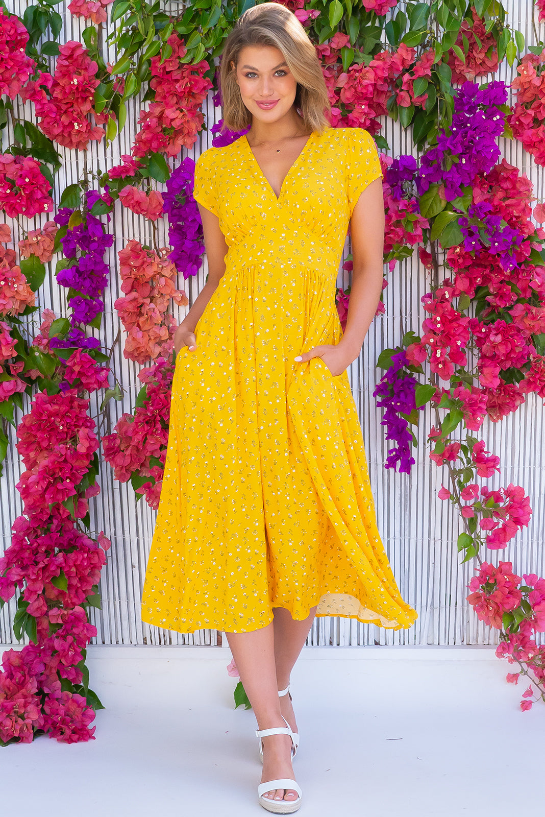 The Lizzie Dandelion Yellow Dress features fitted basque waist with gathered bust, deep side pockets and 100% rayon in sunshine yellow base with sweet daisy print.