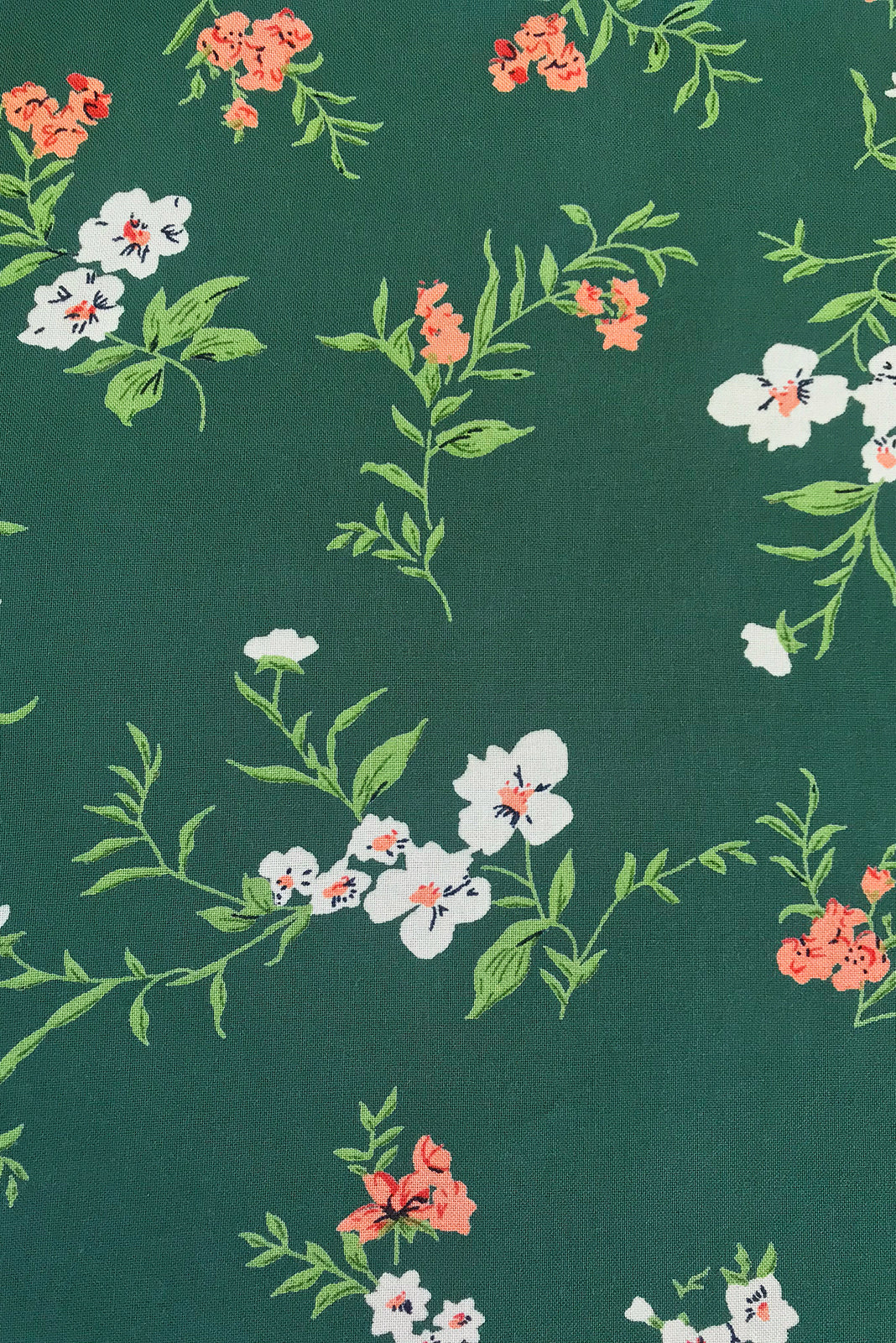 Fabric swatch of  Lizzie Green Gables Dress featuring 100% rayon in muted green base with vintage inspired floral print.