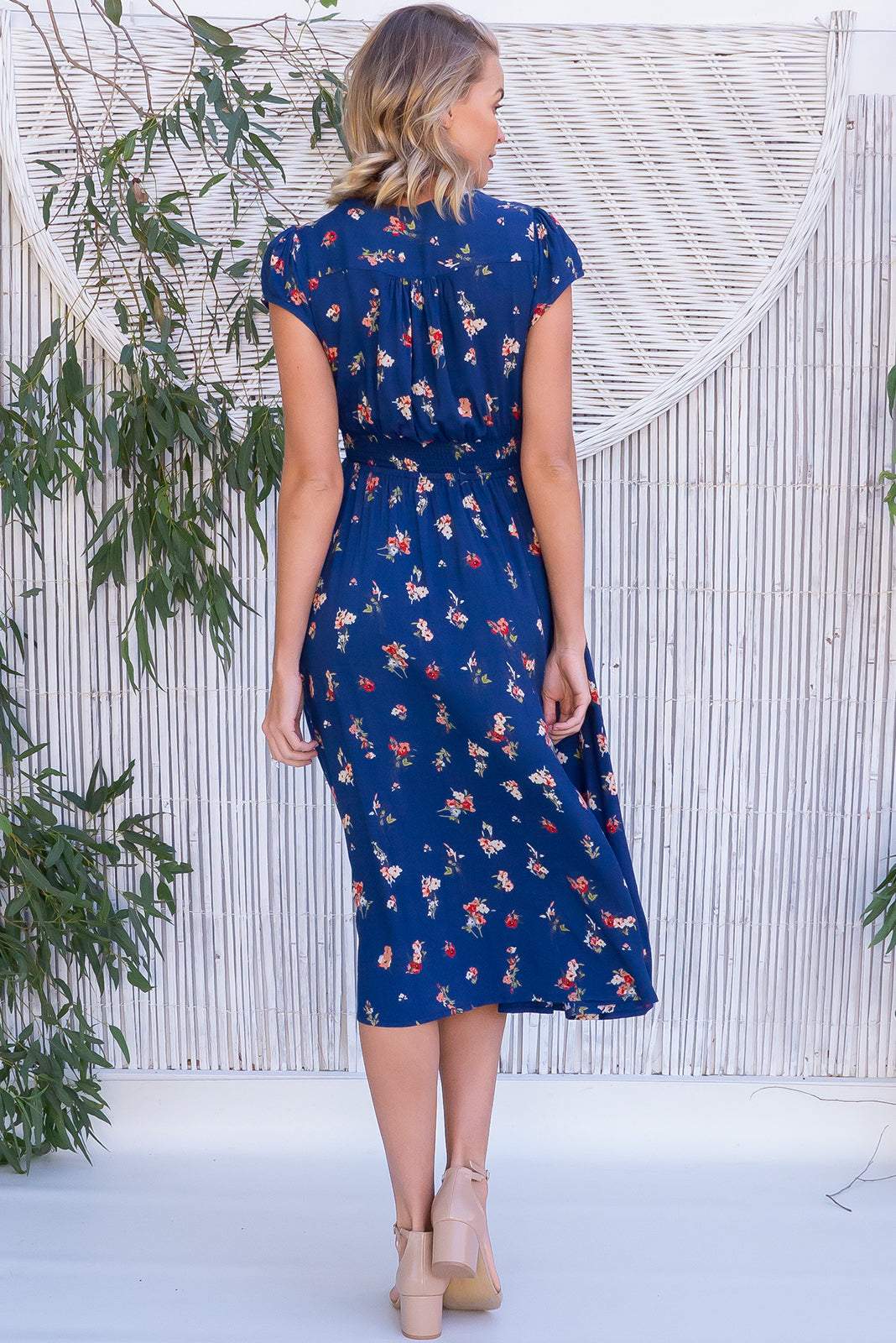 Lizzie Lazuli Blue Dress has waist features elastic shirring at back, deep side pockets, soft sapphire blue base with sprinkles of cream and pink flowers in 100 % woven rayon.