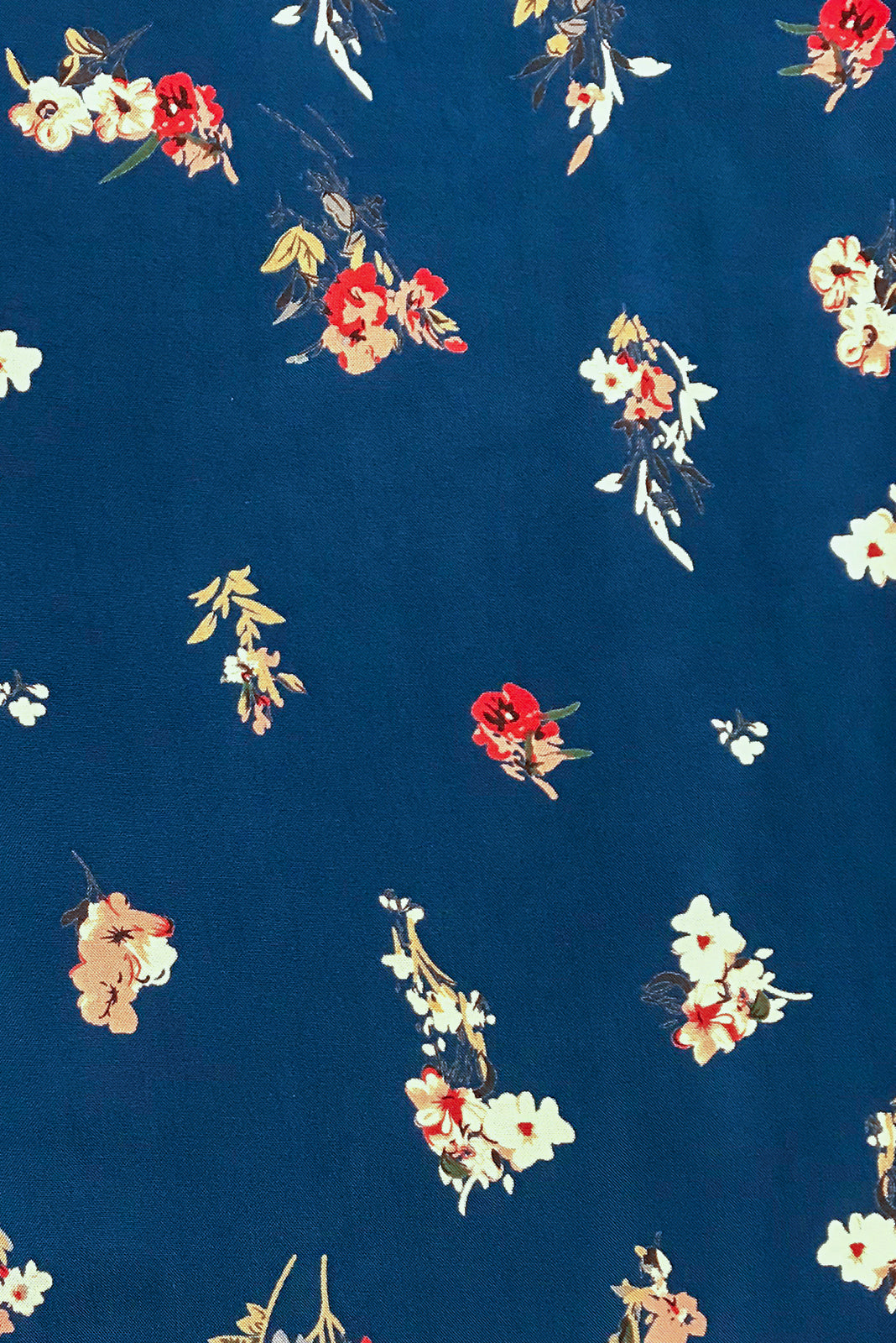 Fabric Swatch of Lizzie Lazuli Blue Dress features  soft sapphire blue base with sprinkles of cream and pink flowers in 100 % woven rayon.