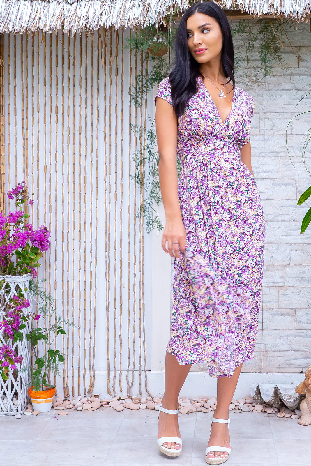 The Lizzie Pansy Purple Dress is such a romantic dress featuring fitted basque waist with gathered bust, waist features elastic shirring at back, petite side pockets and 100% rayon in vintage inspired pansy flowers print in purples, soft yellow and green.