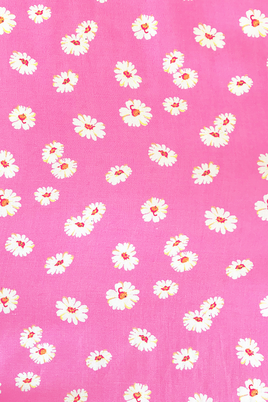 Fabric swatch of Lizzie Pink Spring Dress featuring 100% rayon in bright, taffy pink base with sweet daisy print.