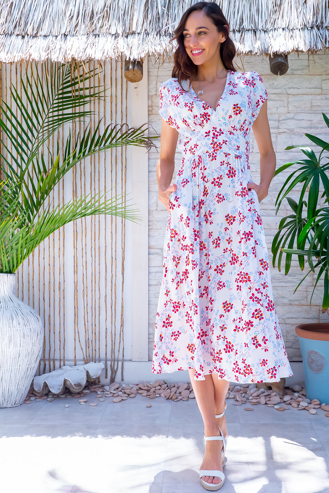 Popular Lizzie Dress now comes in white, the Lizzie Wonderland White Dress features fitted basque waist with gathered bust, deep side pockets and 100% rayon in white base with powder blue and red blossom print.