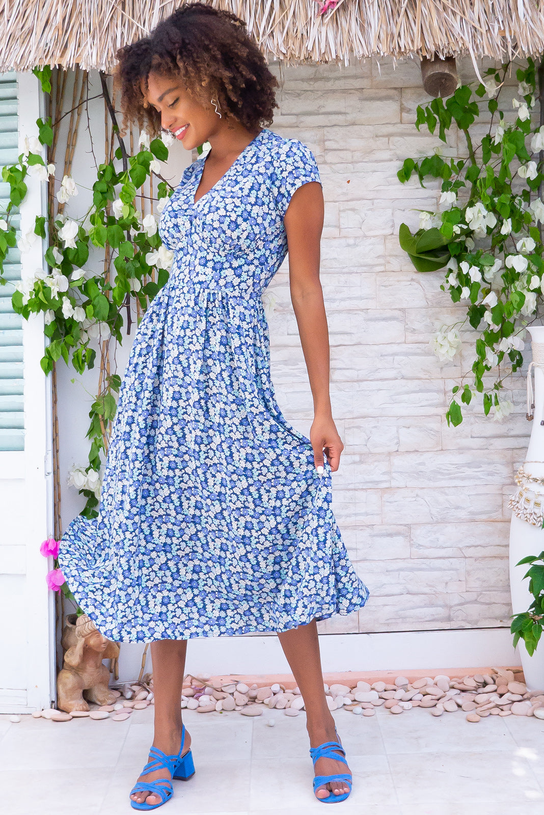 Lizzie Blue Daisies Midi Dress, retro inspired frock has fitted basque waist with gathered bust, waist features elastic shirring at back, deep side pockets, navy base with blue, teal and cream floral print in woven 100% rayon.