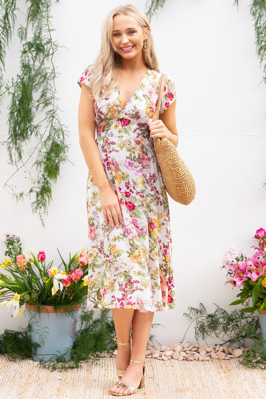 Lizzie Fleur Jolie Cream Midi dress features a vintage inspired fitted basque waist and elasticated waist with a cap sleeve and deep v neck the fabric is a soft woven rayon in a warm cream bouquet floral print