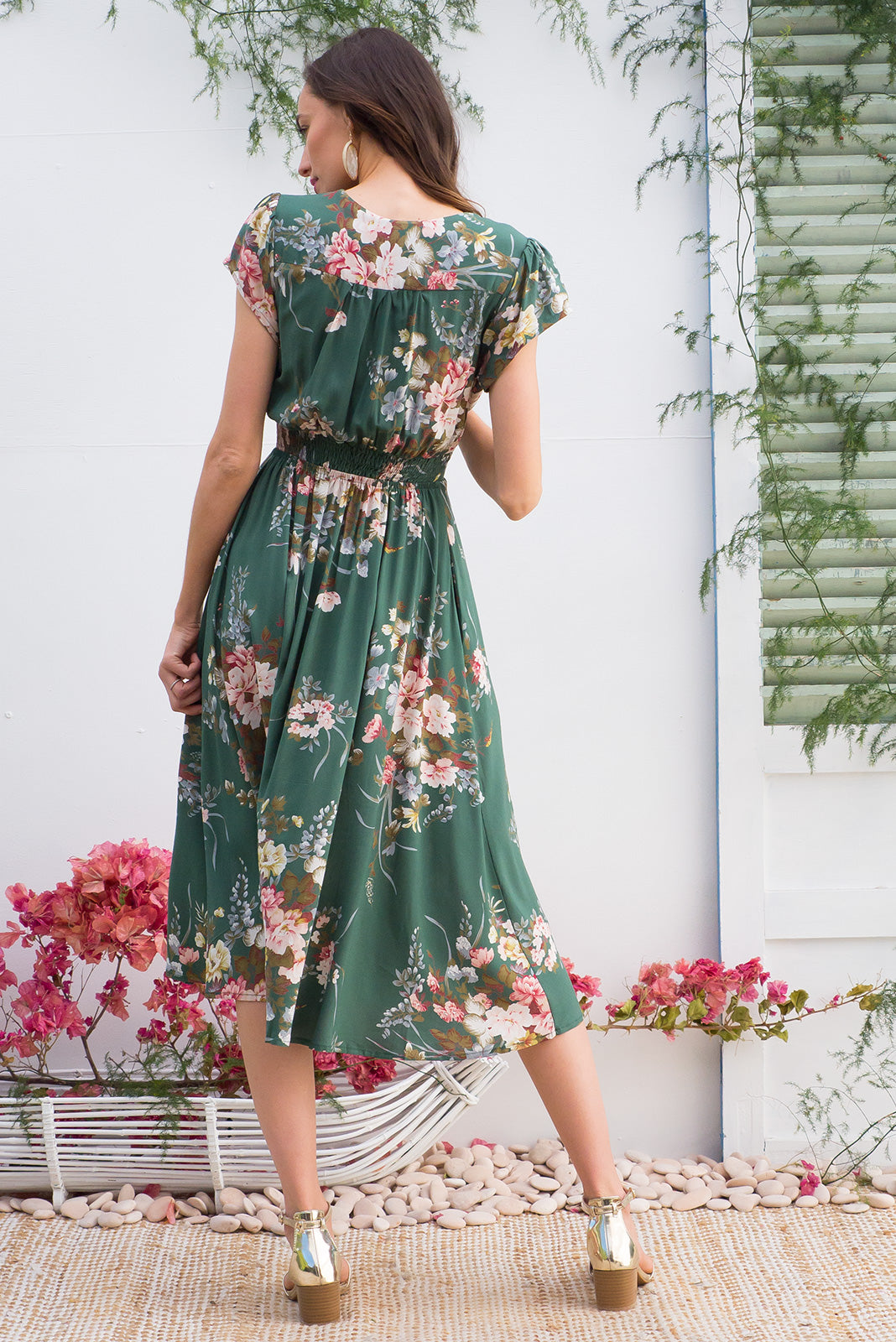 Lizzie Green Bouquet Midi dress features a vintage inspired fitted basque waist and elasticated waist with a cap sleeve and deep v neck the fabric is a soft woven rayon in a soft green bouquet floral print