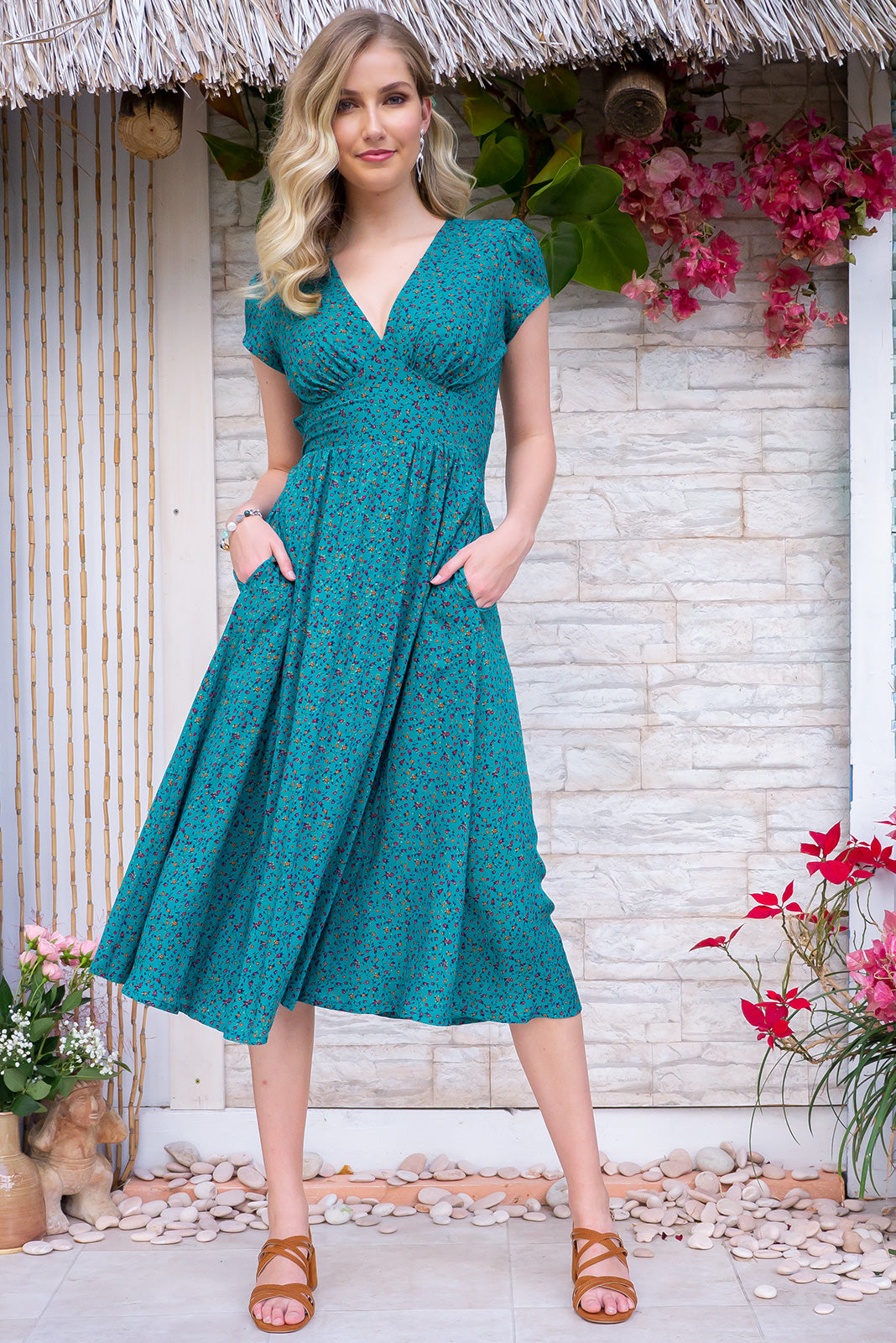 Lizzie Jade Isle Midi Dress - a vintage inspired classic design. Features a rich jade base rayon fabric sprinkled with a tiny floral print. Side pockets, v neck, basque waist, cap sleeves.