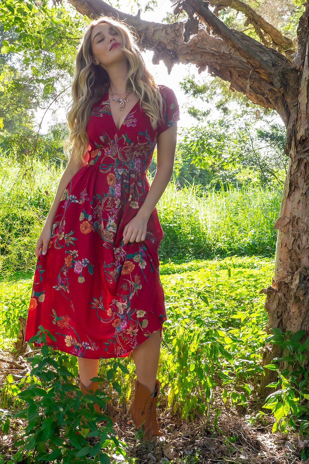 Lizzie Red Bouquet Midi dress features a vintage inspired fitted basque waist and elasticated waist with a cap sleeve and deep v neck the fabric is a soft woven rayon in a bright red bouquet floral print