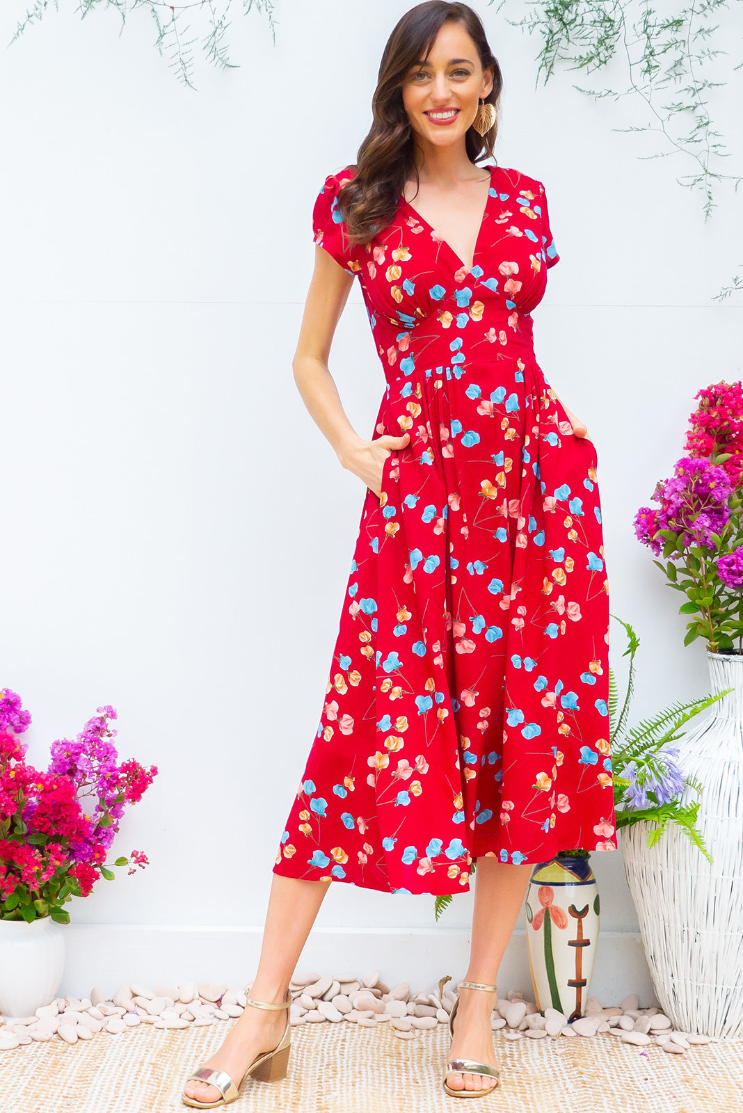 Lizzie Red Poppies Midi dress features a vintage inspired fitted basque waist and elasticated waist with a cap sleeve and deep v neck the fabric is a soft woven rayon in a strong red poppy floral print