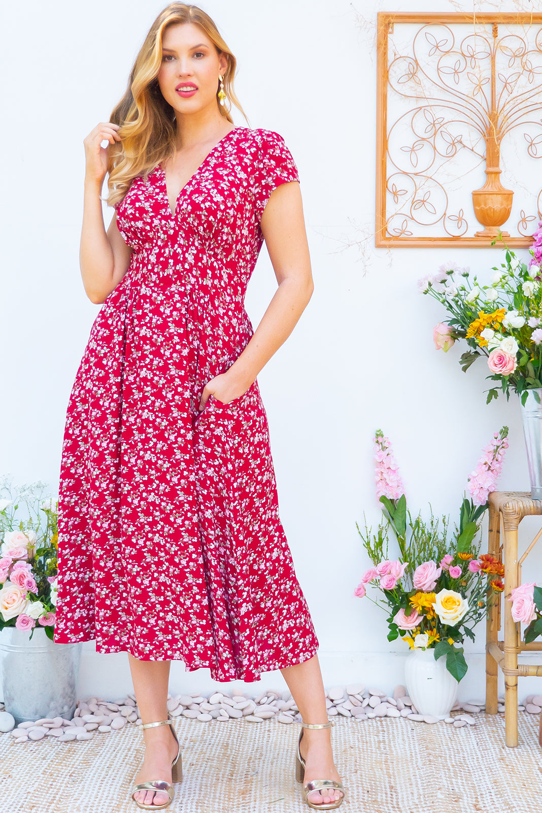 Lizzie Red Tahalia Midi dress features a vintage inspired fitted basque waist and elasticated waist with a cap sleeve and deep v neck the fabric is a soft woven rayon in a bright red small floral print
