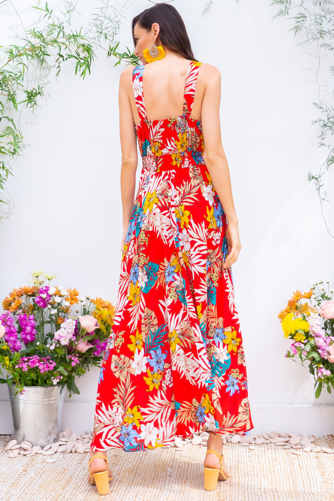 Lola Rouge Jungle Maxi Dress features a vintage inspired fitted basque waist and elasticated waist with a sleeveless design and deep v neck the fabric is a soft woven rayon in a bright red and multicoloured jungle print
