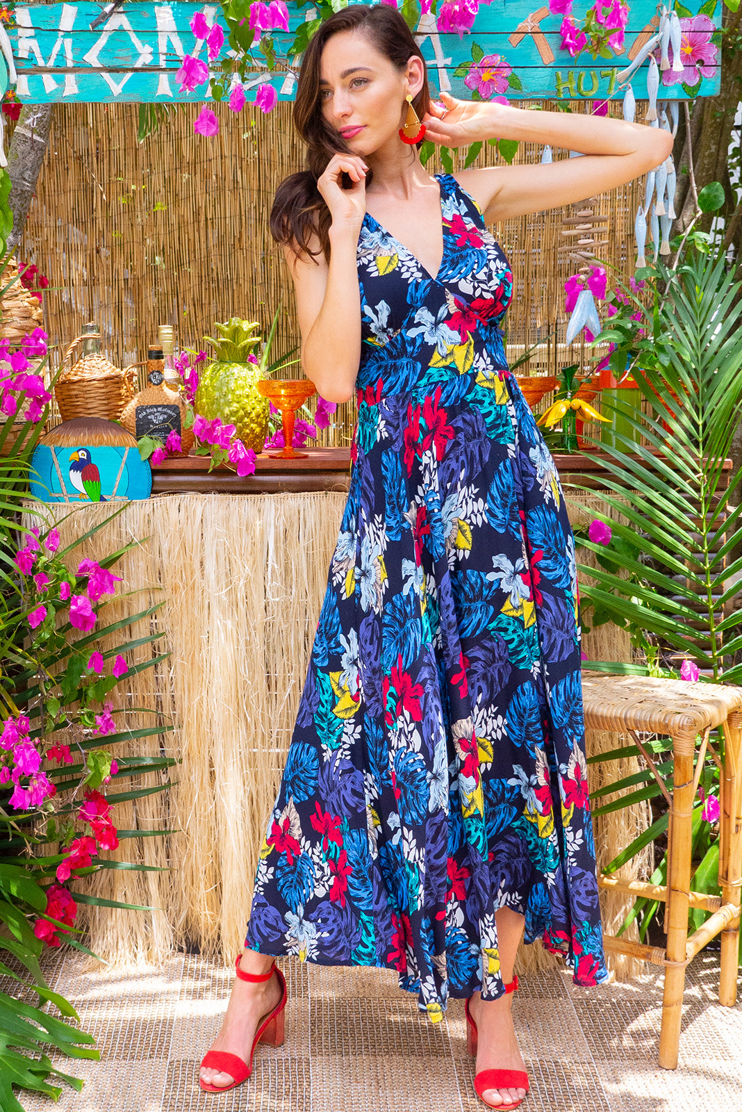 Lola Navy Delicia Maxi Dress features a vintage inspired fitted basque waist and elasticated waist with a sleeveless design and deep v neck the fabric is a soft woven rayon in a navy and multicoloured dark bright jungle floral print