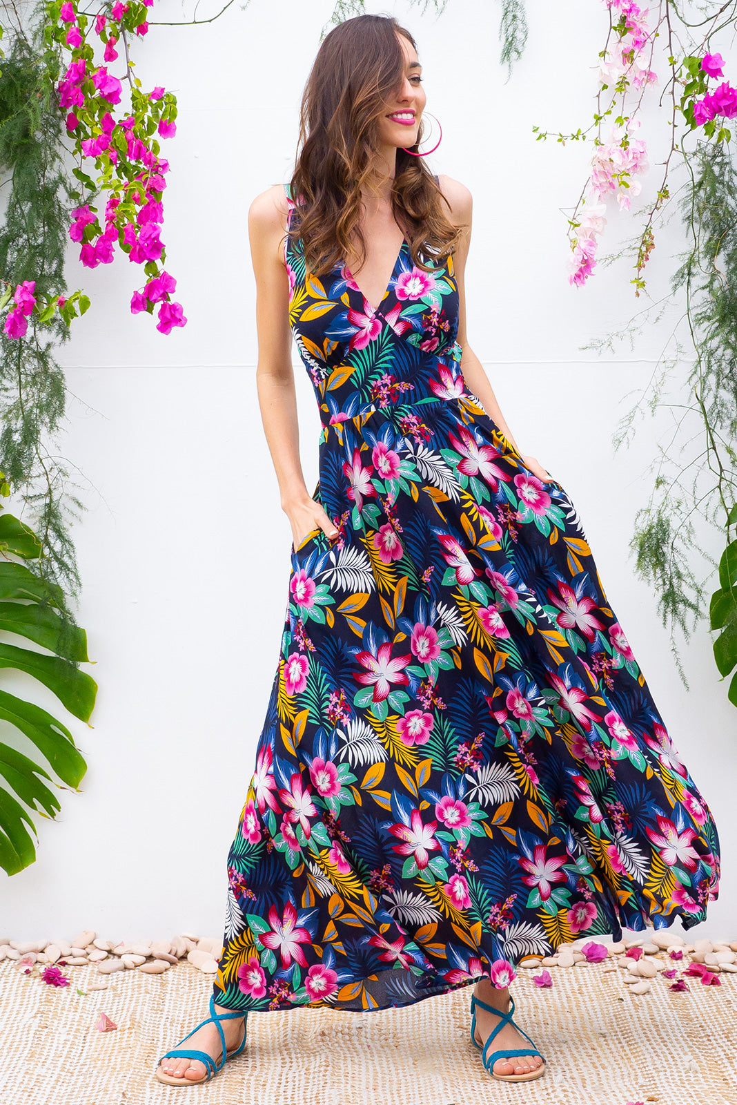 Lola Neon Jungle Maxi Dress features a vintage inspired fitted basque waist and elasticated waist with a sleeveless design and deep v neck the fabric is a soft woven rayon in a navy and multicoloured dark bright jungle print