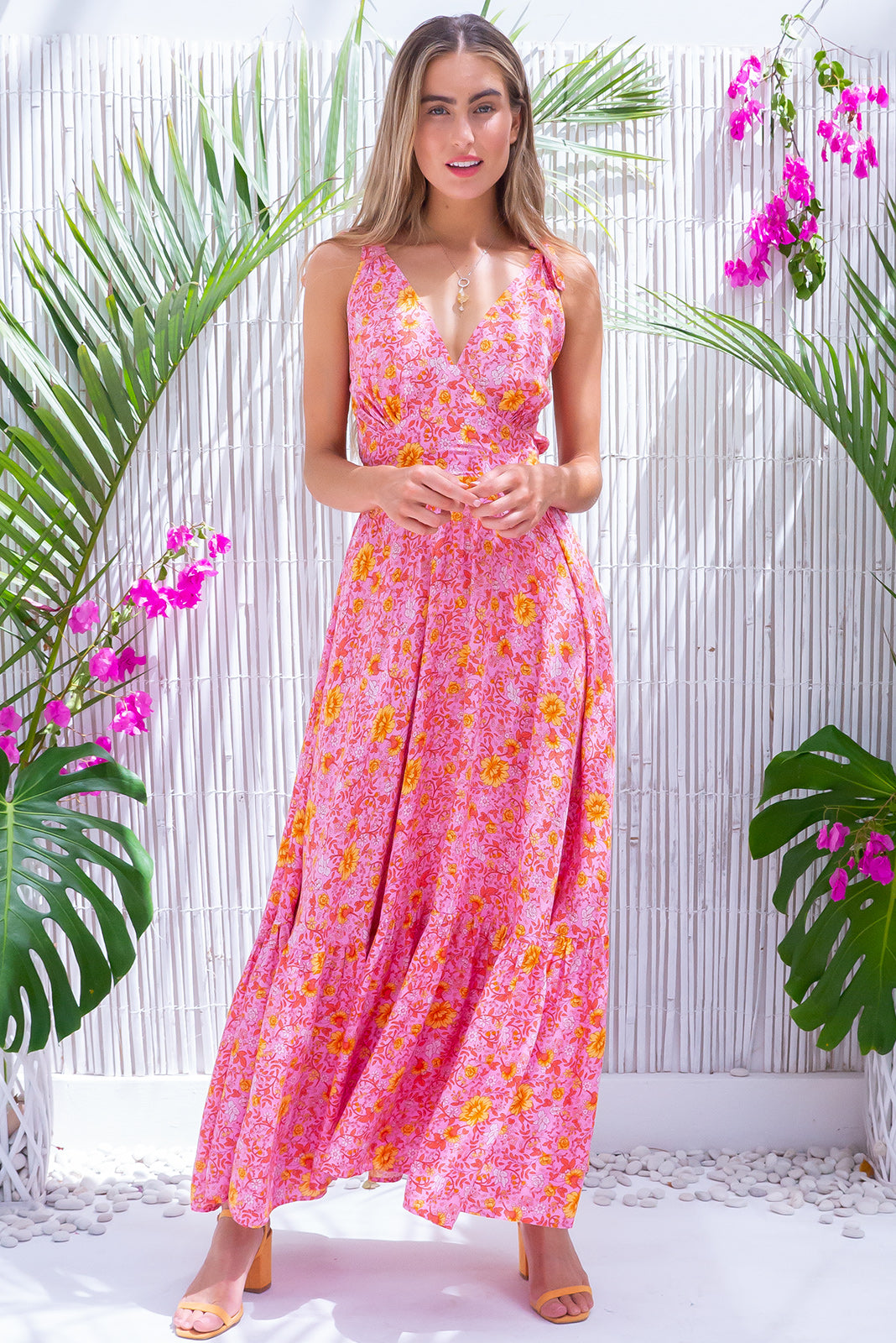 Luana Emma Pink Maxi Dress, bohemian summers style, 100% viscose, lightweight fabric, adjustable shoulder ties, shirred elasticated back, flattering front basque waist, side pockets, warm pink base with medium orange and peach floral print.
