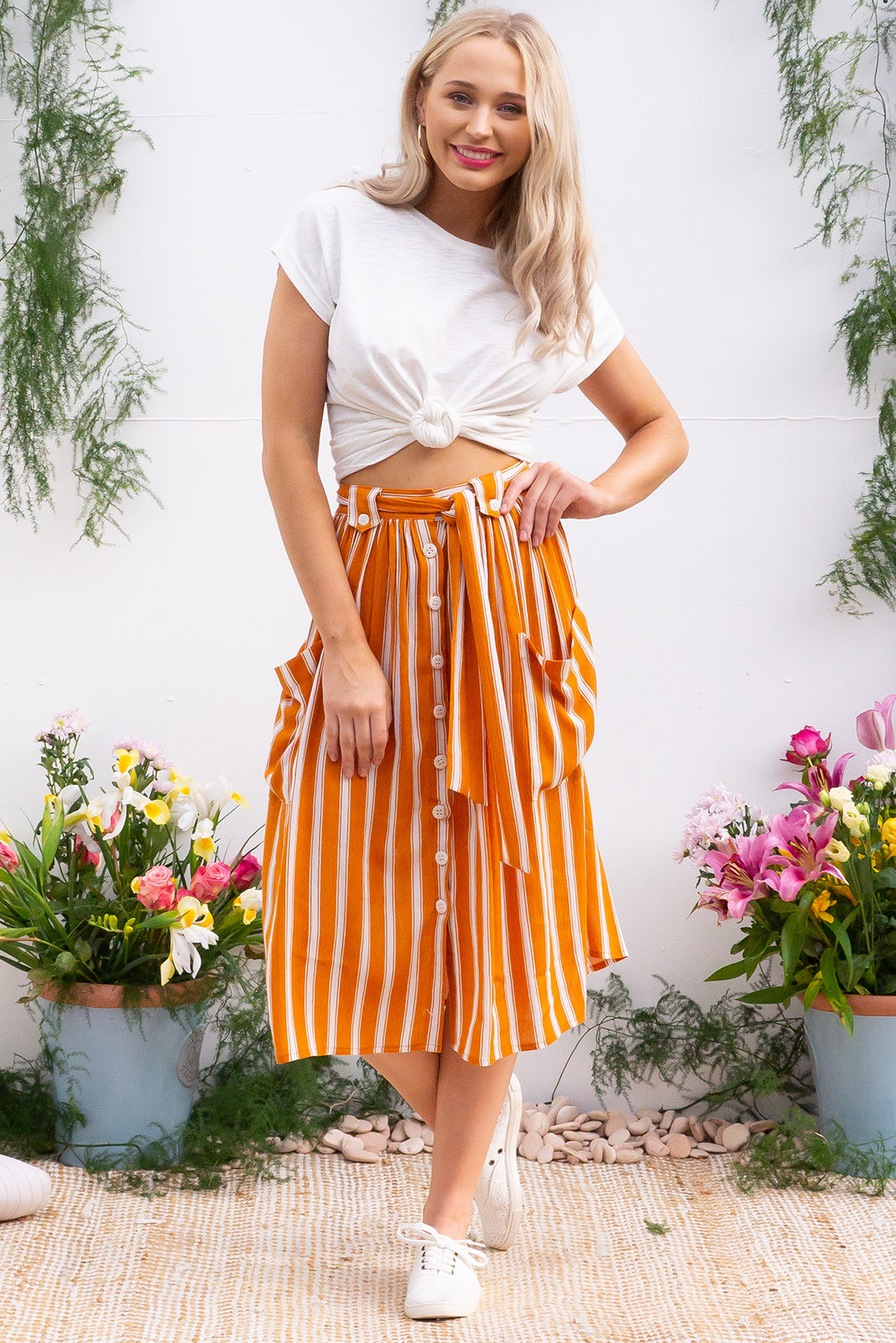 Luisa Burnt Orange button front crinkle textured 100% rayon skirt with 2 deep front pockets, an elastic waistband, and self belt in a bright burnt orange retro inspired stripe
