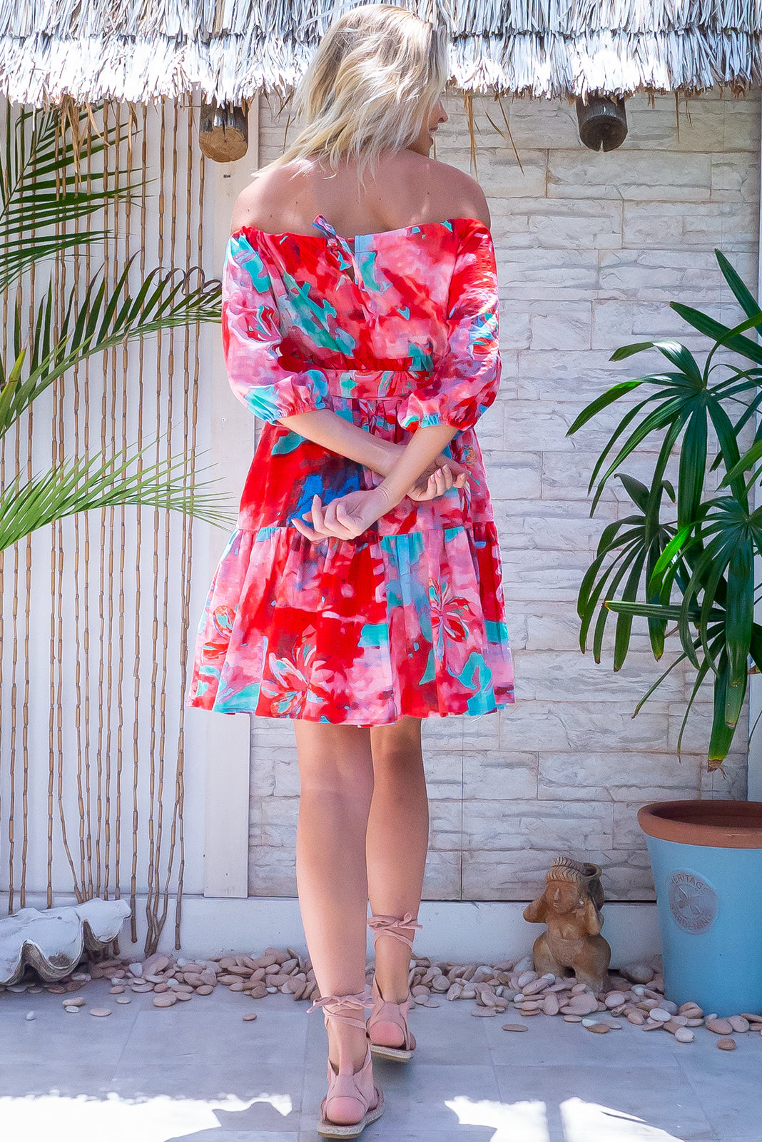 Summer must-have dress is here, the Lulu Babe Summer Splash Swing Mini Dress features small side pockets, fabric belt included, elasticated sleeve cuffs for puff effect and 100% cotton in red, pink, aqua watercolour print.