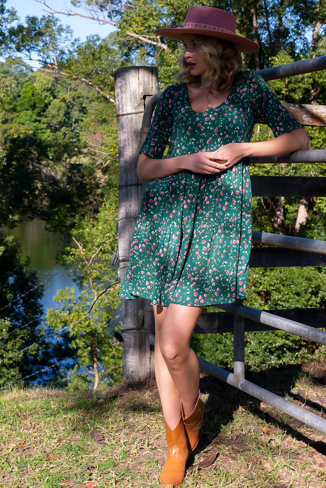 Lulu Bell Green Rosebuds Mini Dress features side pockets, tiered skirt and crinkle textured woven 100% viscose in rich green base with sweet ditzy floral print.