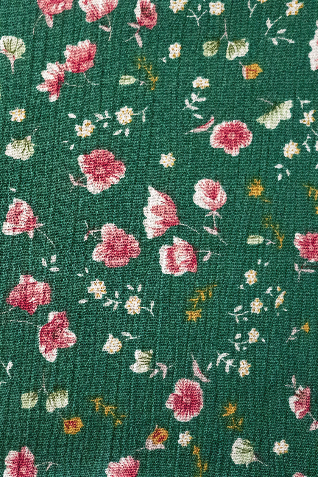 Fabric Swatch of Lulu Bell Green Rosebuds Mini Dress featuring crinkle textured woven 100% viscose in rich green base with sweet ditzy floral print.