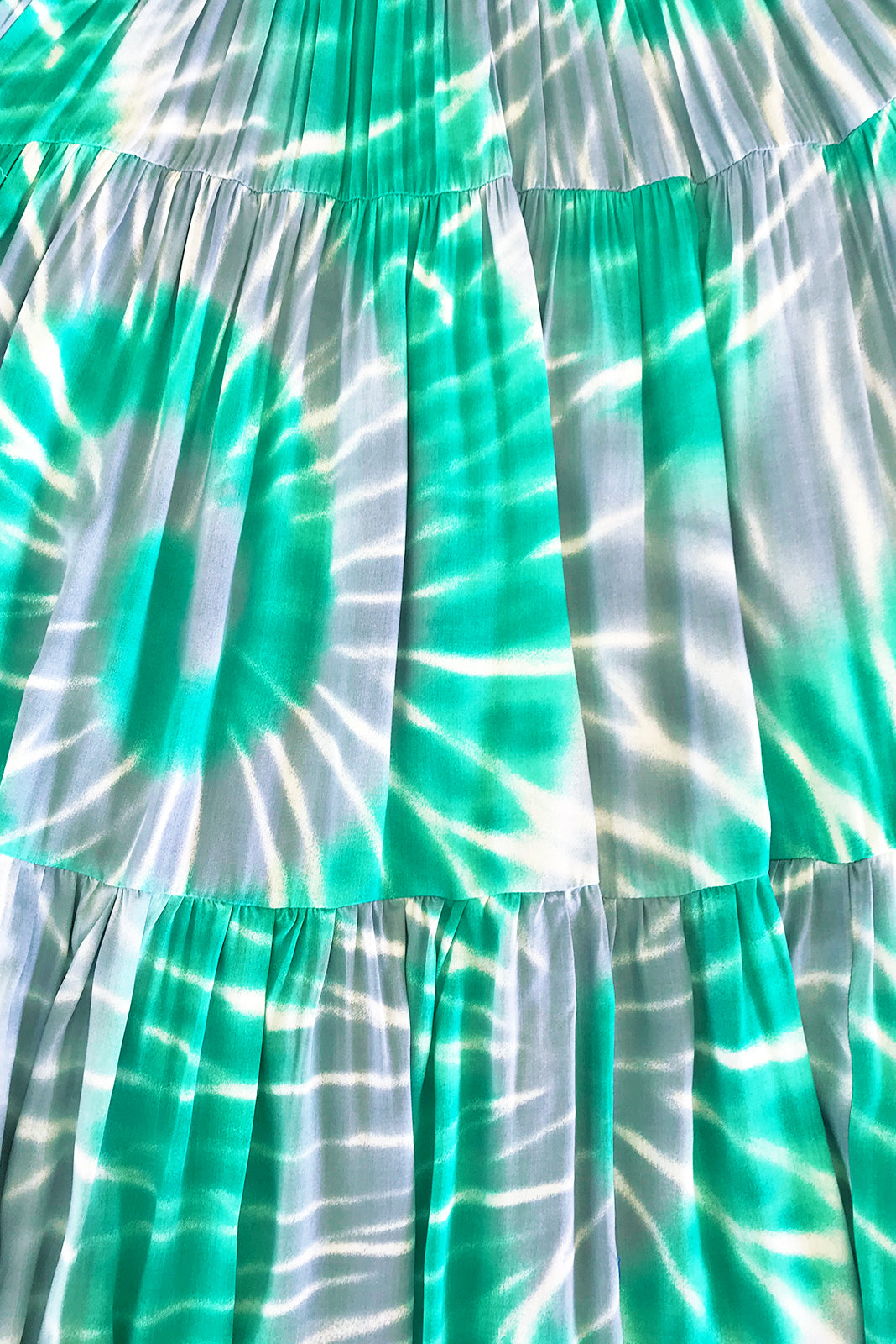 Fabric Swatch of Lulu Darling Aqua Ripples Maxi Dress featuring 100% rayon in silvery grey and lagoon green ripple print.
