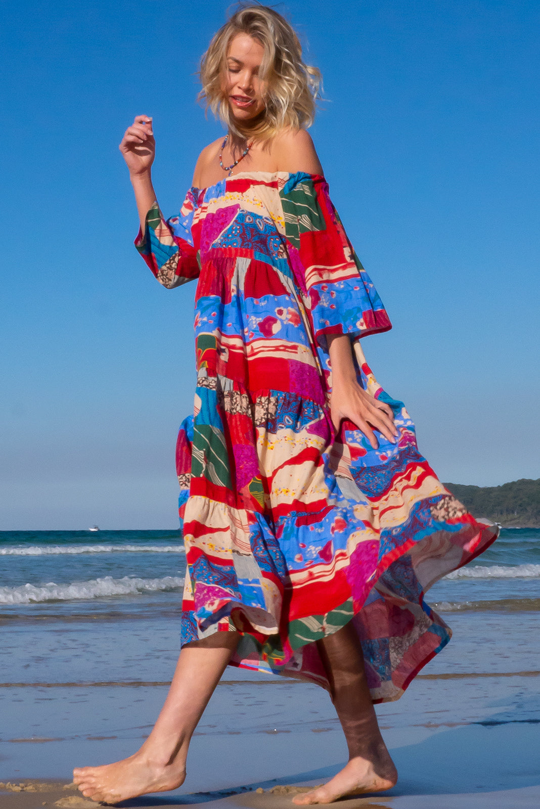 The Lulu Liberty Red Fanfare Swing Maxi Dress can be worn 2 ways, off the shoulder style or on top of shoulders in scooped neck style and features adjustable tie, fabric belt included to cinch in waist and 100% cotton in retro, multicoloured patchwork print.