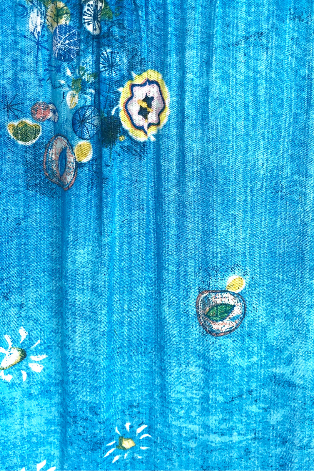 Fabric Swatch of lulu Loves Clear Water Blue Maxi Dress featuring 100% cotton in blue wash effect base with abstract floral print.