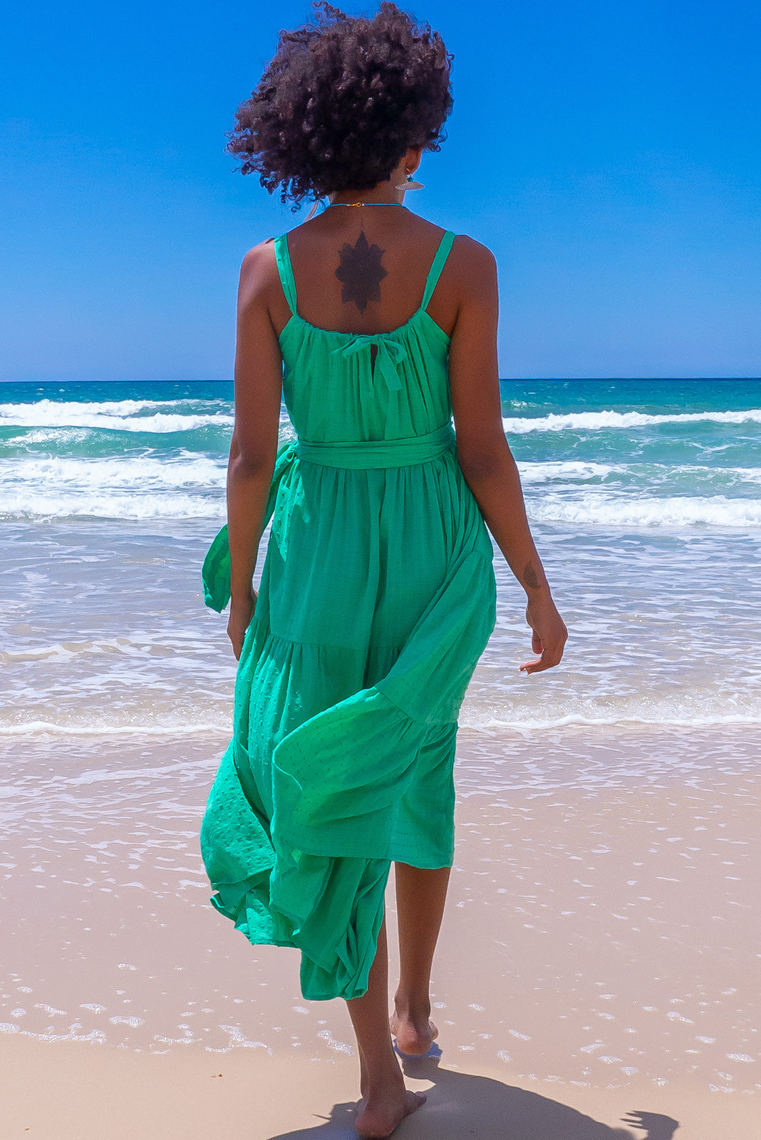 Our easy breezy Lulu Loves Maxi Dress in Electric green is the perfect weekend style featuring tiered maxi skirt, hidden side pockets and 100% cotton in bright apple green base with a soft tonal check and a self coloured swiss spot / dobby.