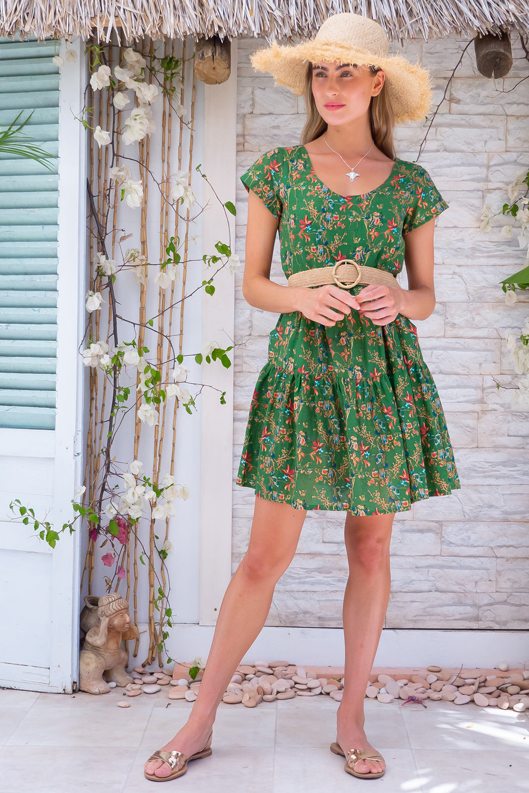 Lulu Elle Jungle Green Mini Dress, bohemian summer style, 100% cotton, slightly sheer, side pockets, tiered skirt, warm toned green base with small coral, gold, teal and white floral print.