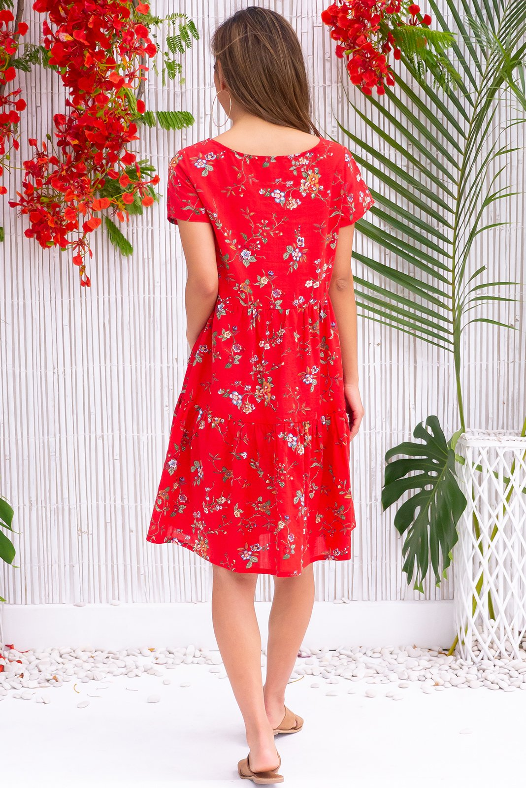 Lulu Elle Ruby Red Dress, bohemian summer style, 100% cotton, slightly sheer, scooped neckline, cap sleeves, side pockets, tiered skirt, bright and bold red base with small white, gold and forest green botanical print.